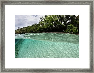 Clear Water Bathes A Tropical Island Framed Print