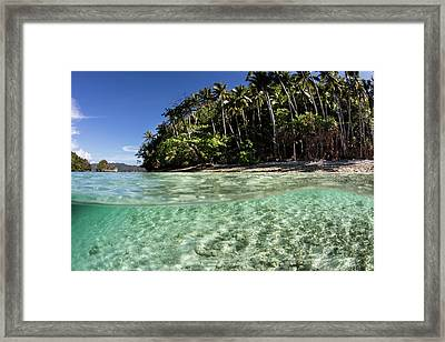 Clear Water Sweeps By A Remote Island Framed Print by Ethan Daniels
