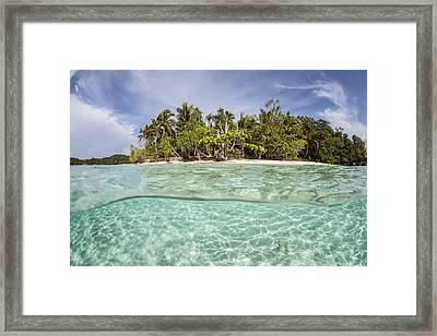 Clear Waters Surround A Remote Island Framed Print by Ethan Daniels