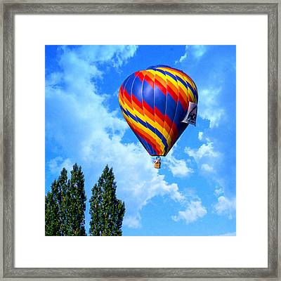 Clearing The Tree Tops Framed Print by Ken Evans