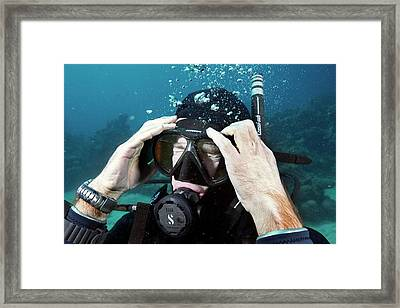 Clearing Water-filled Diving Mask Framed Print by Louise Murray