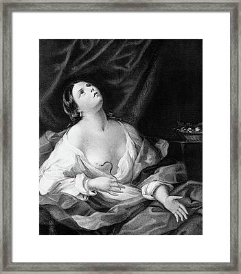 Cleopatra Committing Suicide Clutching Framed Print