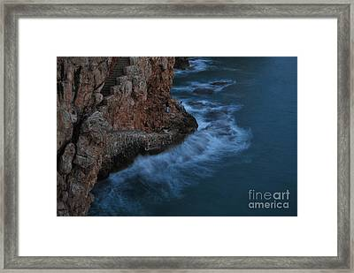 Cliffman Framed Print by Erhan OZBIYIK