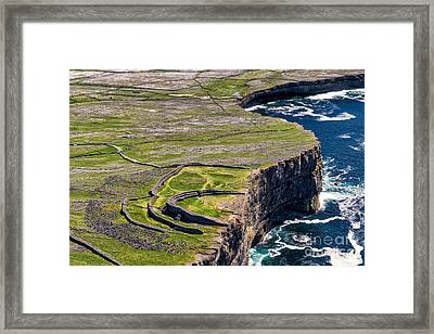 Cliffs Of Inishmoore Framed Print by Juergen Klust
