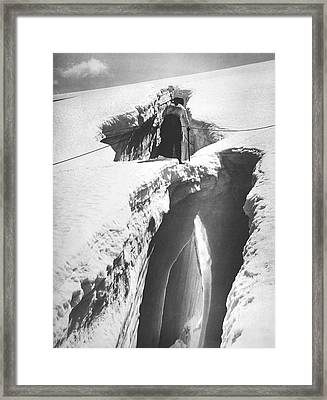 Climber Crossing An Ice Bridge Framed Print by Underwood Archives