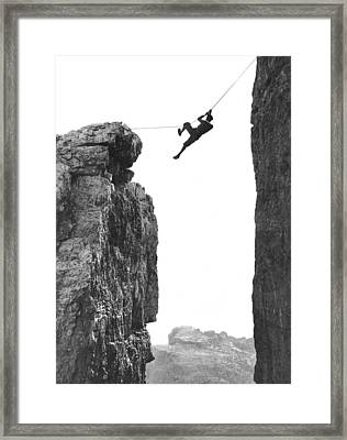 Climber Crossing On A Rope Framed Print by Underwood Archives