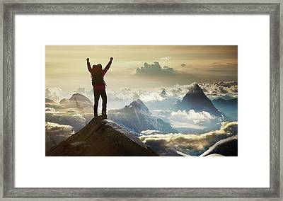 Climber Standing On A Mountain Summit Framed Print by Buena Vista Images