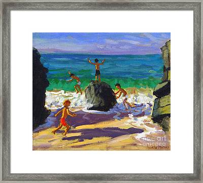 Climbing Rocks Porthmeor Beach St Ives Framed Print by Andrew Macara