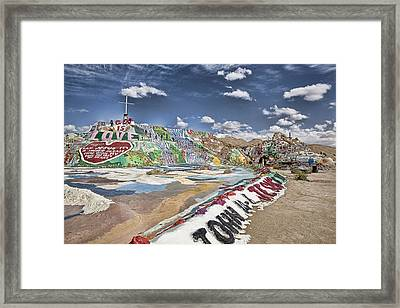 Climbing Salvation Mountain Framed Print by Hugh Smith