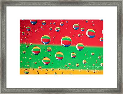 Clolrful Water Drop Reflections Framed Print by Sharon Dominick