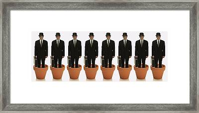 Clones Of Man In Business Suit Standing Framed Print by Darren Greenwood