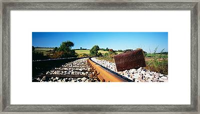 Close-up Of A Suitcase On A Railroad Framed Print
