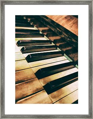 Close Up Of An Old Piano Framed Print