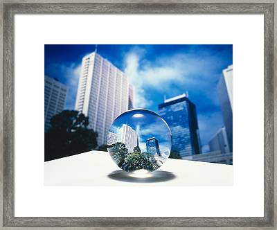 Close Up Of Clear Globe With White Sky Framed Print by Panoramic Images