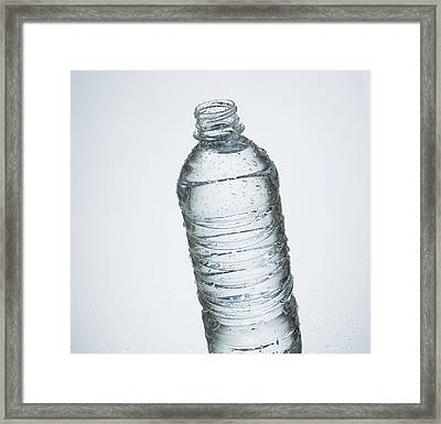 Close-up Of Disposable Water Bottle Framed Print by Bruno Crescia