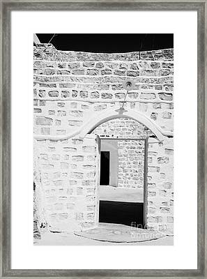 close up of front doorway entrance to family home berber troglodyte underground dwelling at Matmata Tunisia Framed Print