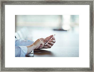 Close-up Of Hands Scrolling On Phone Framed Print by Klaus Vedfelt