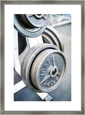 Close-up Of Weight Plates Framed Print by Science Photo Library