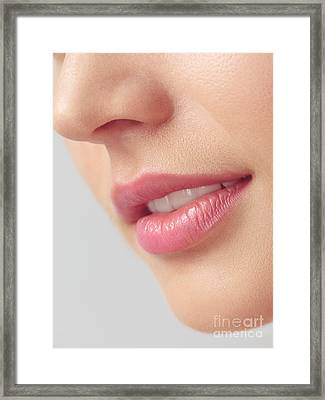 Closeup Of Woman Mouth With Pink Lips Framed Print by Oleksiy Maksymenko