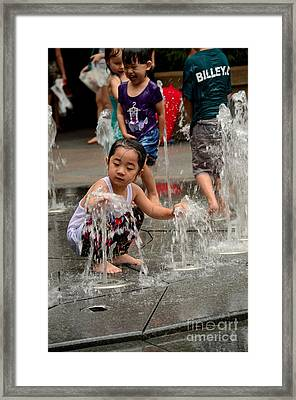 Clothed Children Play At Water Fountain Framed Print