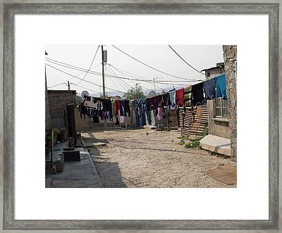 Clothes Hanging Outside Houses Framed Print