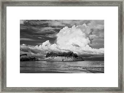 Cloud Boat And Cliffs On Corfu Framed Print by Paul Cowan
