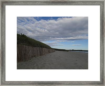 Clouded Beach Framed Print by Robert Nickologianis