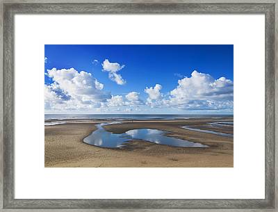 Clouds Across The Beach Framed Print