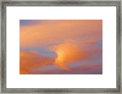 Clouds At Sunrise Framed Print by Dan Sherwood