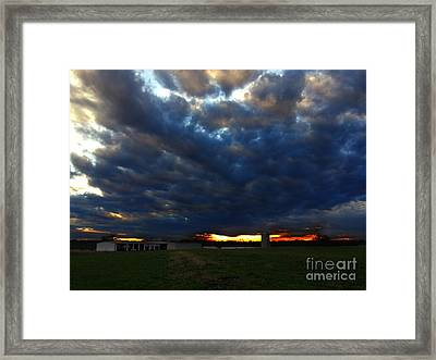 Clouds At Sunset Framed Print by Lisa Holmgreen
