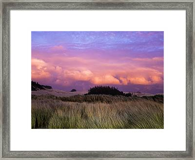 Clouds Catch Light From The Setting Sun Framed Print by Robert L. Potts