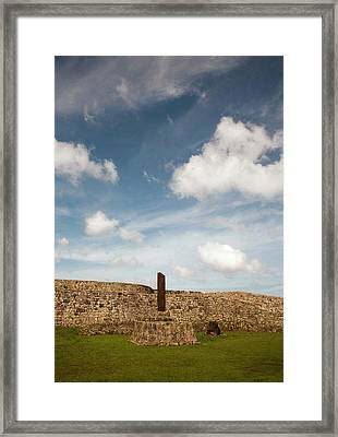 Clouds Drift Over The Stone Walled Framed Print by Dave Bartruff