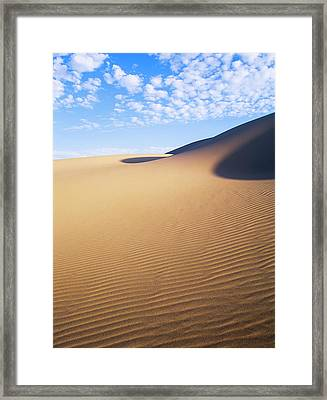 Clouds Drift Over The Umpqua Dunes Framed Print by Robert L. Potts