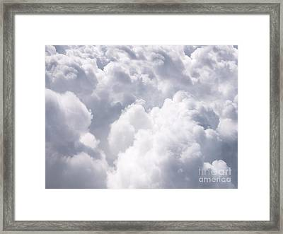 Clouds From Above Background Framed Print by Paul Velgos