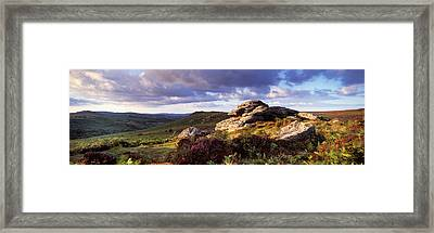 Clouds Over A Landscape, Haytor Rocks Framed Print by Panoramic Images