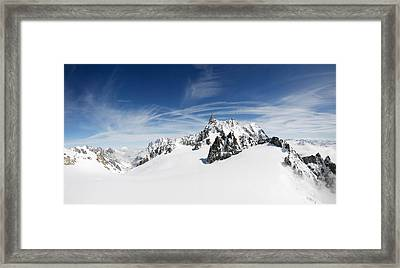 Clouds Over A Snow Covered Mountain Framed Print