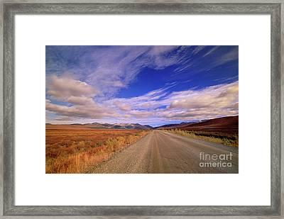 Clouds Over Fall Tundra  Framed Print by Yva Momatiuk John Eastcott