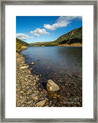 Clouds Over Lake  Framed Print by Adrian Evans