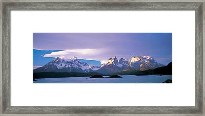 Clouds Over Snow Covered Mountains Framed Print