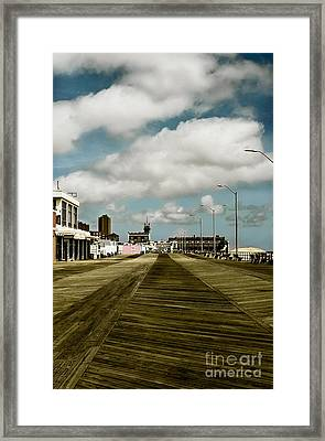 Clouds Over The Boardwalk Framed Print
