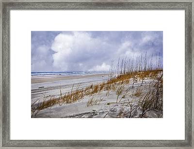 Clouds Over The Dunes Framed Print by Debra and Dave Vanderlaan