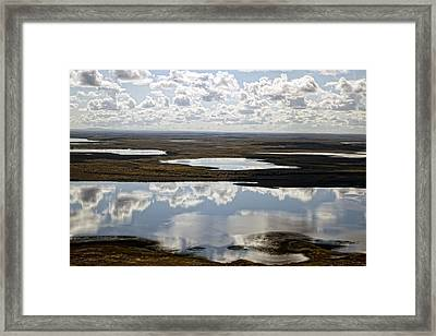 Clouds Reflected In Aleutian Lakes Framed Print by Michael Riley