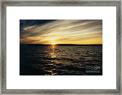 Clouds Stretching Across The Sky Framed Print by John Telfer