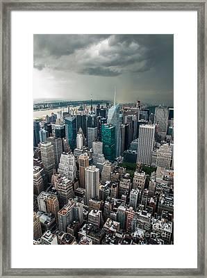 cloudy Manhattan Framed Print by Hannes Cmarits