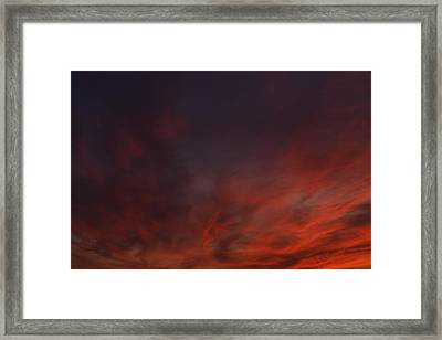 Cloudy Red Sunset Framed Print