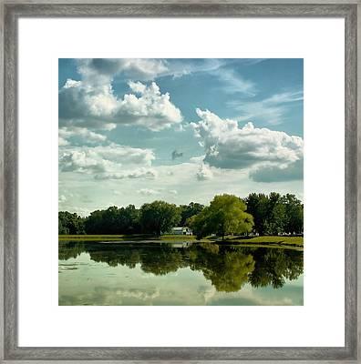 Cloudy Reflections Framed Print by Kim Hojnacki