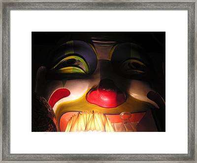 Clown In The Antique Shop Framed Print