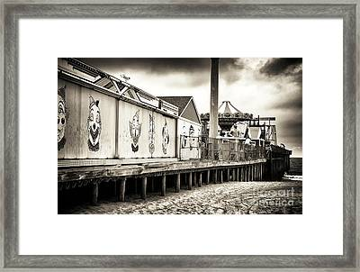 Clowns On The Pier Framed Print by John Rizzuto
