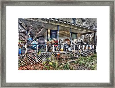 Clutter House Porch  Framed Print by Dan Friend