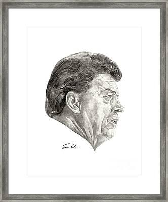 Coach Framed Print by Tamir Barkan